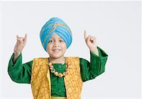 punjabi - Portrait of a boy doing bhangra and smiling Stock Photo - Premium Royalty-Freenull, Code: 630-01708780