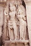 Statues of lord Shiva and goddess Parvati carved in a cave, Ellora, Aurangabad, Maharashtra, India