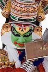 Close-up of a Kathakali dance performer applying make-up on his face Stock Photo - Premium Royalty-Free, Artist: Westend61, Code: 630-01709927