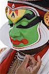 Close-up of a Kathakali dance performer applying make-up on his face Stock Photo - Premium Royalty-Free, Artist: Westend61, Code: 630-01709930