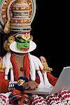 Close-up of a Kathakali dance performer using a laptop Stock Photo - Premium Royalty-Free, Artist: Westend61, Code: 630-01709964