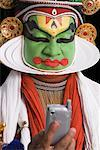 Close-up of a Kathakali dance performer holding a mobile phone Stock Photo - Premium Royalty-Free, Artist: Westend61, Code: 630-01709967