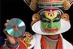 Portrait of a Kathakali dance performer holding a CD Stock Photo - Premium Royalty-Free, Artist: Westend61, Code: 630-01709970