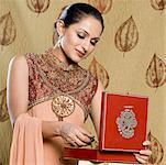 Close-up of a mid adult woman in salwar kameez and holding a jewelry box Stock Photo - Premium Royalty-Free, Artist: ableimages, Code: 630-01710017