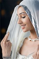 Close-up of a young woman in lehenga choli and smiling Stock Photo - Premium Royalty-Freenull, Code: 630-01710043