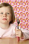 Girl holding a fork Stock Photo - Premium Royalty-Free, Artist: IIC, Code: 628-01711950