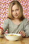 Girl eating cornflakes Stock Photo - Premium Royalty-Free, Artist: foodanddrinkphotos, Code: 628-01711964