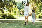 Mother and son, walking hand in hand, rear view Stock Photo - Premium Royalty-Free, Artist: Ty Milford, Code: 633-01714965