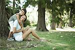 Mother and son sitting outdoors, boy hugging woman from behind Stock Photo - Premium Royalty-Freenull, Code: 633-01715021