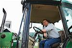 Portrait of Farmer in Tractor    Stock Photo - Premium Royalty-Free, Artist: Masterfile, Code: 600-01716026