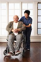 Senior Man Receiving Assistance with Wheelchair    Stock Photo - Premium Royalty-Freenull, Code: 600-01716129