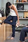 Woman Trying on Shoes    Stock Photo - Premium Royalty-Free, Artist: Michael Mahovlich, Code: 600-01716412