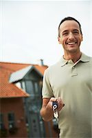 Portrait of Man Holding House Keys    Stock Photo - Premium Rights-Managednull, Code: 700-01716447