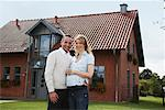Portrait of Couple in Front of House    Stock Photo - Premium Rights-Managed, Artist: Masterfile, Code: 700-01716451