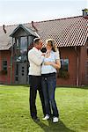 Portrait of Couple in Front of House    Stock Photo - Premium Rights-Managed, Artist: Masterfile, Code: 700-01716452