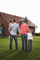 Family Standing in Front of House    Stock Photo - Premium Rights-Managednull, Code: 700-01716522