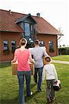 Family Carrying Boxes    Stock Photo - Premium Rights-Managed, Artist: Masterfile, Code: 700-01716525