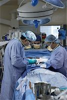 Doctors Performing Open Heart Surgery    Stock Photo - Premium Rights-Managednull, Code: 700-01716538