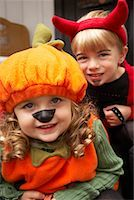 Portrait of Girl Dressed-up as Pumpkin and Boy Dressed-up as Devil    Stock Photo - Premium Royalty-Freenull, Code: 600-01717681
