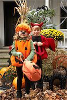 Portrait of Girl Dressed-up as Pumpkin and Boy Dressed-up as Devil    Stock Photo - Premium Royalty-Freenull, Code: 600-01717682