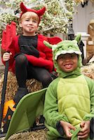 Portrait of Boy Dressed-up as Dragon with Boy Dressed-up as Devil    Stock Photo - Premium Royalty-Freenull, Code: 600-01717684