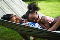 Mother and Daughter Sleeping in Hammock    Stock Photo - Premium Royalty-Freenull, Code: 600-01717920