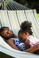 Mother and Daughter Sleeping in Hammock    Stock Photo - Premium Royalty-Freenull, Code: 600-01717921