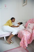 Mother Tucking Daughter into Bed    Stock Photo - Premium Royalty-Freenull, Code: 600-01717969