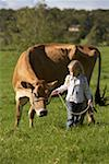 Young girl (6-7) walking with cow on meadow Stock Photo - Premium Royalty-Free, Artist: Photosindia, Code: 613-01730063