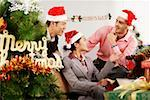 Office men and woman chatting on Christmas Day Stock Photo - Premium Royalty-Free, Artist: Marie Blum, Code: 642-01733537
