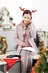 Office woman wearing red horn on the phone behind Christmas tree Stock Photo - Premium Royalty-Free, Artist: Marie Blum, Code: 642-01733558