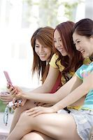 Young women with mobile phone Stock Photo - Premium Royalty-Freenull, Code: 642-01735863