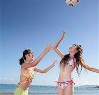 Two young women playing volleyball on beach Stock Photo - Premium Royalty-Freenull, Code: 642-01736052