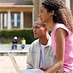 Two students using laptop outside university Stock Photo - Premium Royalty-Freenull, Code: 618-01738129