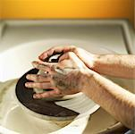 Potter working with clay on wheel close-up of hands Stock Photo - Premium Royalty-Free, Artist: Masterfile, Code: 618-01739042