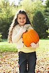 Girl Carrying Pumpkin    Stock Photo - Premium Royalty-Free, Artist: Masterfile, Code: 600-01742498