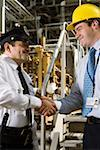 Security guard shaking hands with manager in waste treatment plant Stock Photo - Premium Royalty-Freenull, Code: 604-01742445