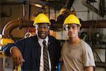 Smiling worker with manager in waste treatment plant Stock Photo - Premium Royalty-Freenull, Code: 604-01742468