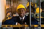 Smiling manager wearing hardhat in waste treatment plant Stock Photo - Premium Royalty-Freenull, Code: 604-01742469