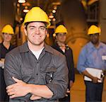 Smiling manager wearing hardhat Stock Photo - Premium Royalty-Freenull, Code: 604-01742482