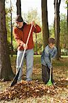 Grandfather and Grandson Raking Leaves    Stock Photo - Premium Royalty-Free, Artist: Masterfile, Code: 600-01742500