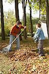 Grandfather and Grandson Raking Leaves    Stock Photo - Premium Royalty-Free, Artist: Masterfile, Code: 600-01742501