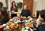 Woman Serving Thanksgiving Dinner