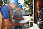 Construction Workers Looking at Document    Stock Photo - Premium Royalty-Free, Artist: Masterfile, Code: 600-01742619
