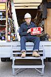 Construction Worker with Help Wanted Sign    Stock Photo - Premium Royalty-Free, Artist: Masterfile, Code: 600-01742683