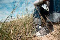Girl Sitting on Beach, Netherlands    Stock Photo - Premium Rights-Managednull, Code: 700-01742700
