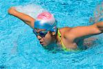 Young woman swimming the butterfly stroke in a swimming pool Stock Photo - Premium Royalty-Free, Artist: Aflo Sport, Code: 625-01744352