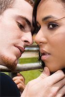 preteen kissing - Close-up of a young man about to kiss a teenage girl Stock Photo - Premium Royalty-Freenull, Code: 625-01746499