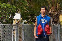 Teenage boy listening an ipod and walking Stock Photo - Premium Royalty-Freenull, Code: 625-01747073