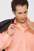 sweaty businessman - Close-up of a businessman blowing in a shirt Stock Photo - Premium Royalty-Freenull, Code: 625-01748439